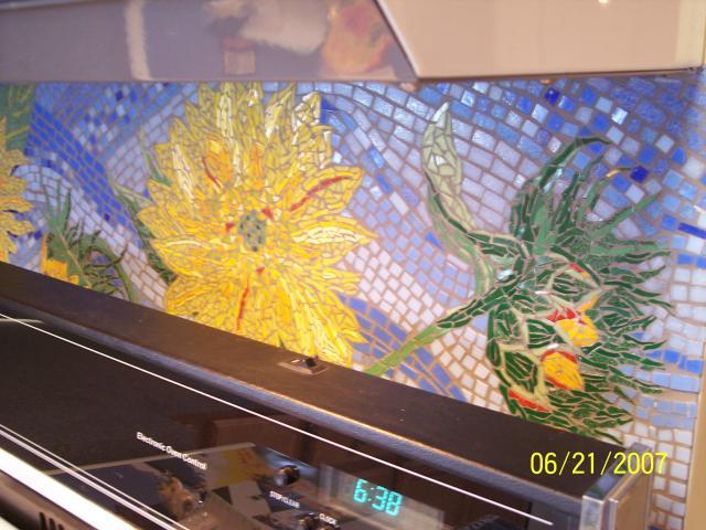 Third panel behind stove